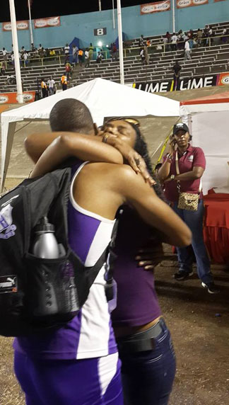 zharnel hughes hugs his mother after running in the 2014 ISSA championships in Jamaica