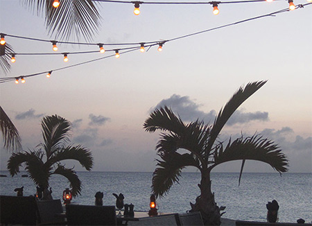 evening time at straw hat restaurant on meads bay, anguilla