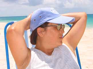 Mom in chair on Barnes Bay beach in Anguilla